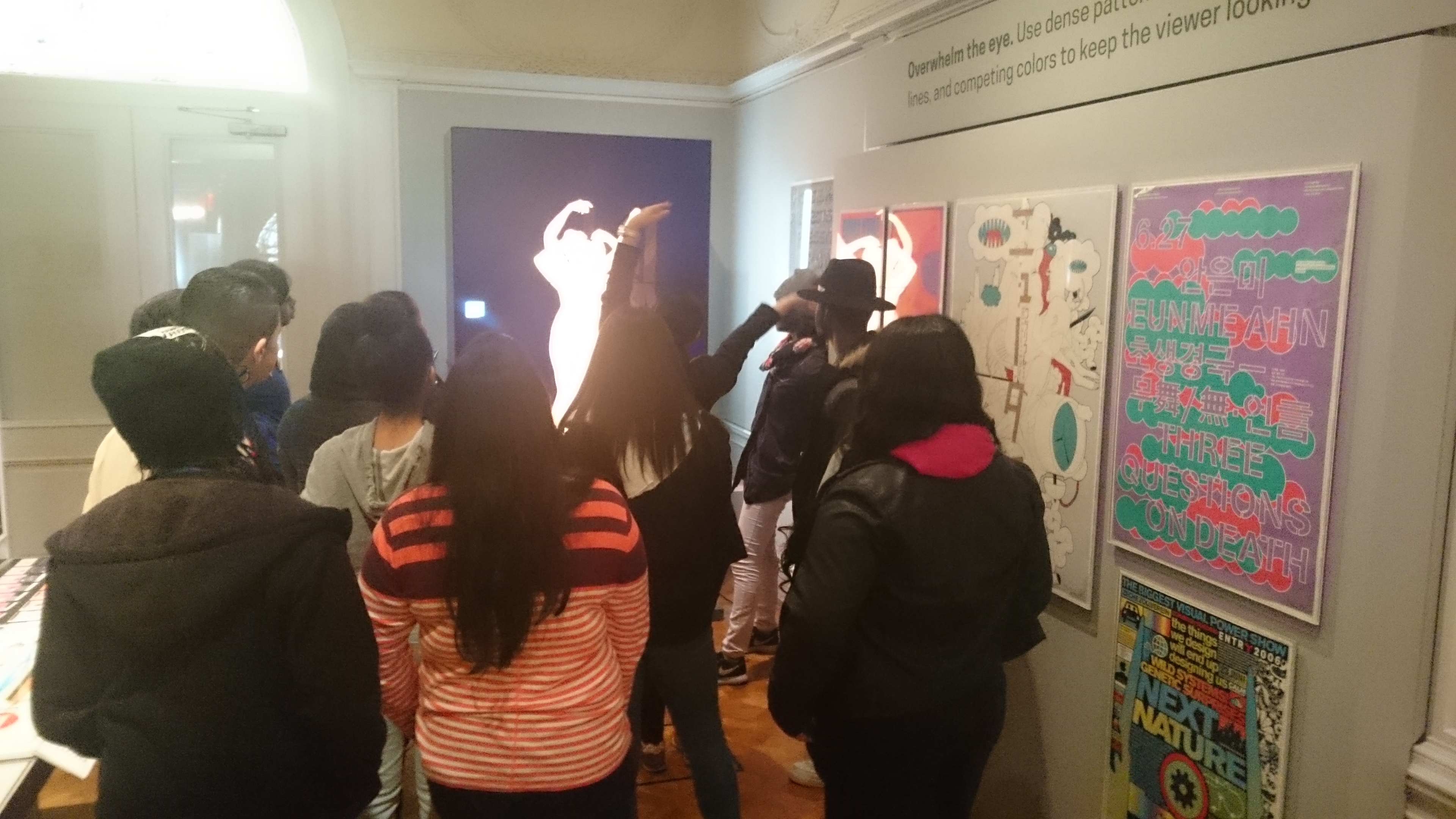 picture of group using full body gestures to browse the collection