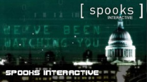 """A screenshot of the Spooks Interactive game, with the title and logo overlaid on a London skyline with St Paul's cathedral and the words """"We've been watching you"""" in the sky"""